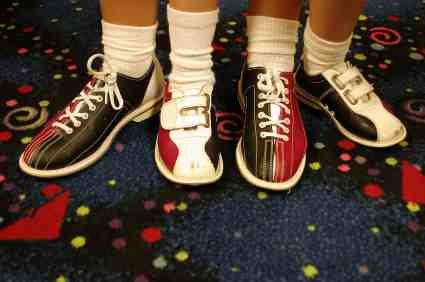 Photo of brightly colored adult and child bowling shoes copyright Jamie Wilson from iStockPhoto #000000817792