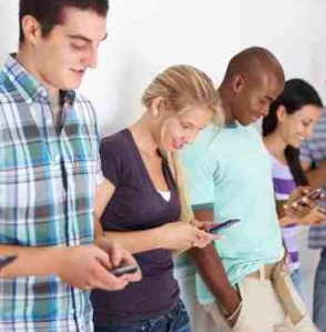 Students texting copyright PixDeluxe iStockPhoto #000014390567 cropped