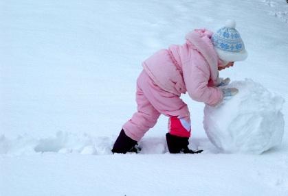Little Girl Rolling Snowman Phase 1 copyright Jen D iStockPhoto #000001319904