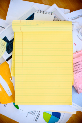 yellow notepad and papers