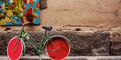 Green bicycle with watermelon slice wheels