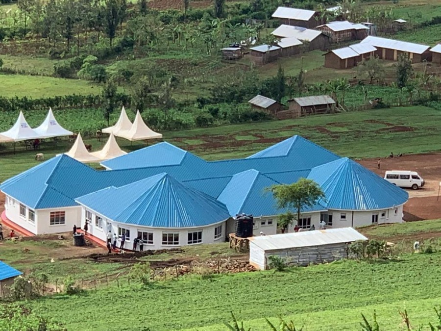 New hospital in Bukwo, Uganda, with blue conical roofs over round wings based on traditional design.