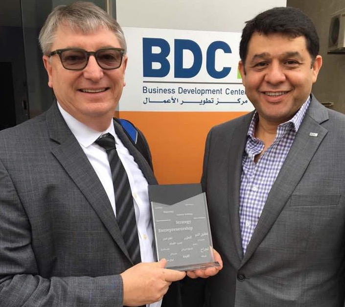 Professor Denis Leclerc of Thunderbird School of Global Management receives a token of appreciation from Nayef Stetieh, founder of BDC, Business Development Center, during a visit at BDC in Amman, Jordan.