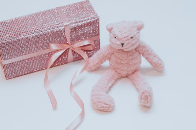 photo of pink crocheted bear and gift box